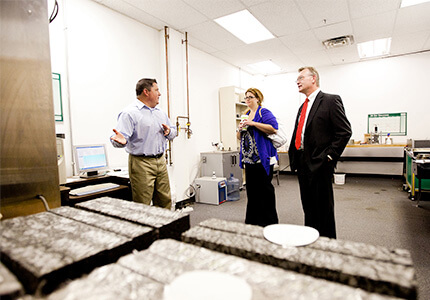visitors touring CAIT asphalt pavement lab