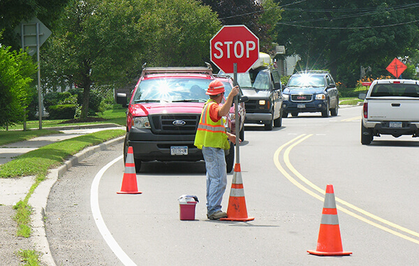 Worker directing traffic in a work zone