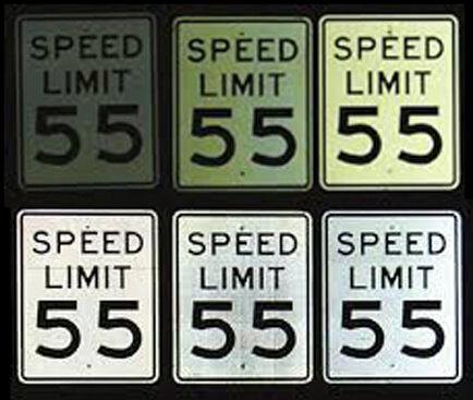 speed limit signs showing various retroreflectivity from dim to bright