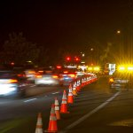 nighttime work zone with police and traffic