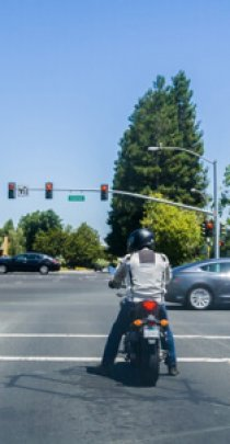 : motorcycle and traffic at a busy intersection