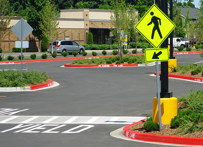 pedestrian crossing sign and road markings