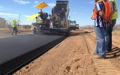 road crew laying new pavement