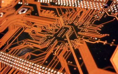 "computer_circuitboard_orange_iS71322.jpg alt=""computer circuit board"