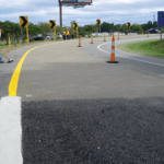 Roadway being paved with High Friction Surface Treatment