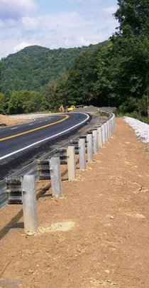 guardrail along a curvy mountain road