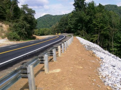 guardrail along a curvy mountain road