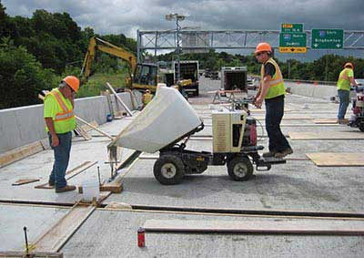 Construction workers on I-81 connecting bridge panels