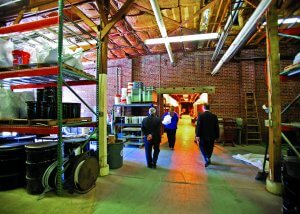 people walking through the materials-storage area of the asphalt lab