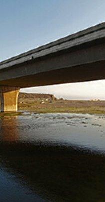 concrete bridge over a shallow creek