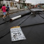 road sign and utility poles after Hurricane Maria