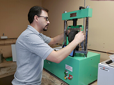 Lab engineering Ed Haas performing the IDEAL-CT test.