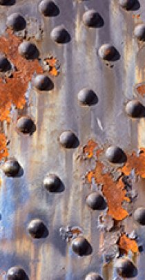 rusted steel plate and rivets