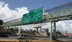 Damaged pedestrian bridge with signs attached (front view)
