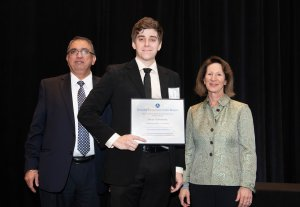 Noah Thibodeaux receives award.